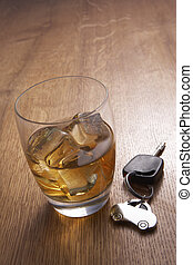 A glass of alcohol and car keys
