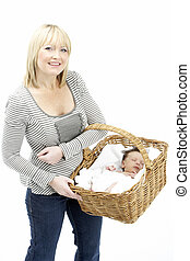 Newborn Baby Held In Basket By Mother