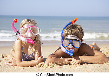 Young children on beach holiday