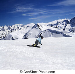 Snowboarding in mountains. Caucasus Mountains, Dombay