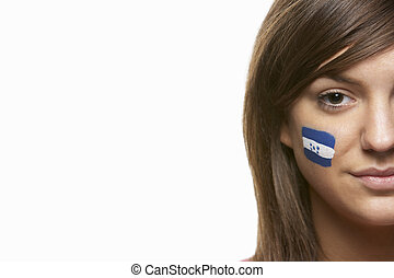 Young Female Sports Fan With Honduras Flag Painted On Face