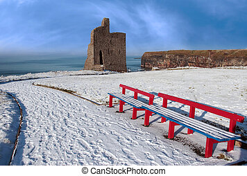 winter view of ballybunion castle and red benches - a...