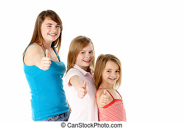 Three Girls Giving Thumbs Up Gesture In Studio