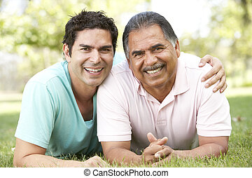 Father With Adult Son In Park