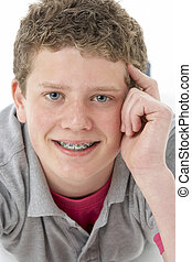 Studio Portrait of Smiling Teenage Boy