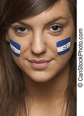 Young Female Sports Fan With Honduran Flag Painted On Face