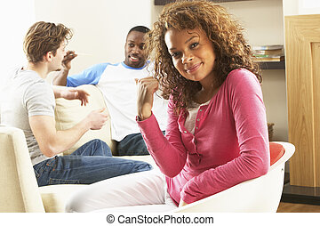 Group Of  Friends Enjoying Chatting Together At Home