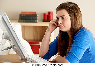 Teenage Girl Using Computer At Home