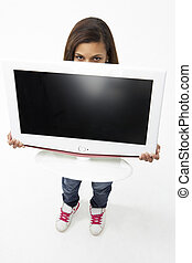 Portrait of Smiling Teenage Girl Holding Television