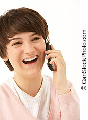 Studio Portrait Of Young Girl Using Mobile Phone