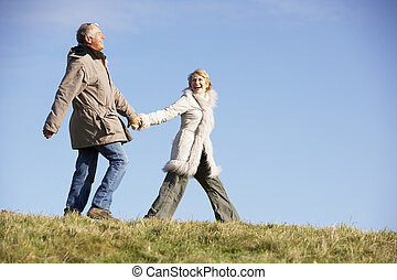 Senior Man Pulling His Wife By The Hand