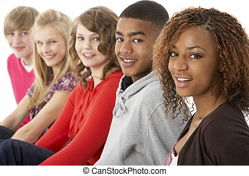 Studio Portrait Of Five Teenage Friends Standing In Line