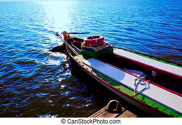 Albufera blue boats lake in El Saler Valencia