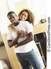 Romantic Young Couple Embracing In Living Room