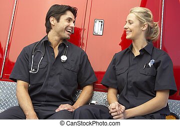 Two paramedics laughing together