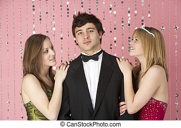 Two Teenage Girls Looking At Boy