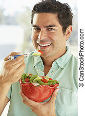Mid Adult Man Holding A Bowl Of Salad, Smiling At The Camera