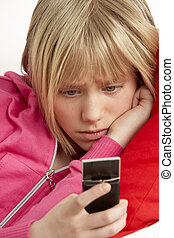 Young Girl Reading Text And Looking Worried
