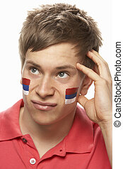 Disappointed Young Male Sports Fan With Serbian Flag Painted...