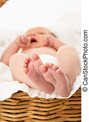 Close Up Of Baby's Feet On Towel