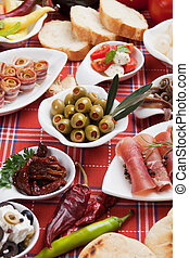 Pickled olives with other antipasto food