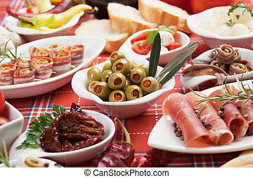 Pickled olives with other antipasto food - Pickled olives...