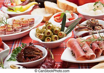 Pickled olives with other antipasto food - Pickled olives...
