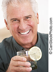Man Having A Drink At Home