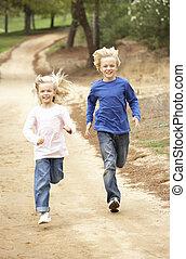 Two Children running in park