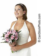 Portrait Of Bride Holding Bouquet Of Flowers