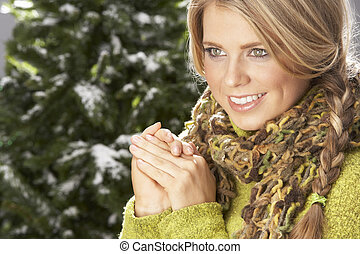 Fashionable Woman Wearing Knitwear And Scarf In Studio In...