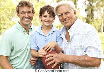 Grandfather With Father And Son Playing American Football...