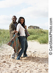 Romantic Young Couple Standing By Dunes