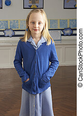 Portrait Of Female Primary School Pupil Standing In...