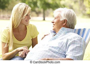 Senior Man Talking To Adult Daughter