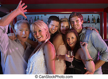 Group Of People Having Fun In Busy Bar