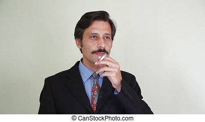 man smoking cigarette - Businessman smoking cigarette, shoot...
