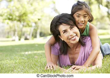 Grandmother With Granddaughter In Park
