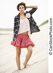 Fashionably Dressed Attractive Young Woman Standing Amongst...