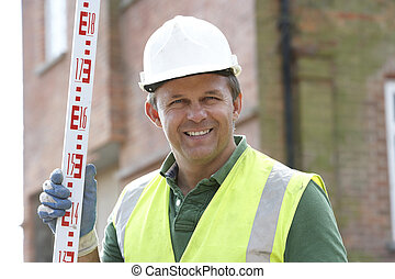 Construction Worker Holding Measure