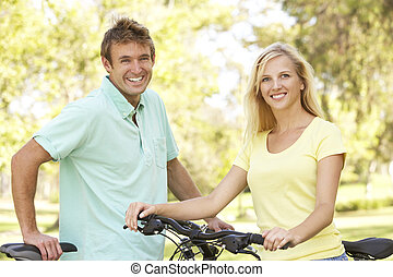 Young Couple On Cycle Ride in Park