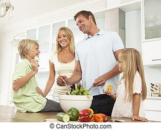 Father & Son Preparing Salad In Modern Kitchen