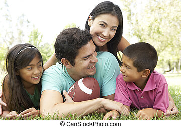 Family In Park With American Football