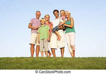 A family, with parents, children and grandparents, posing in...