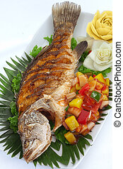 fish - close up view of nice fried fish with vegetables on...