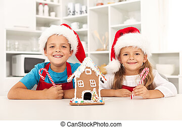 Happy kids at christmas time in the kitchen