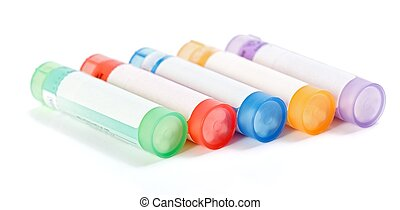 Colorful homeopathic medication containers on white