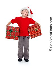 Young boy holding Christmas gifts