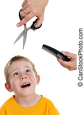 Scared little boy looking up to scissor and comb