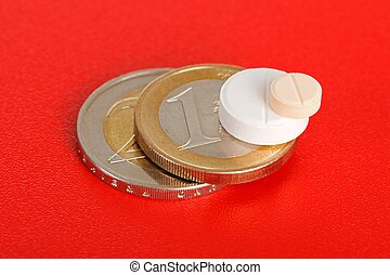 Macro of two pills on top of euro coins - Pair of pills on...
